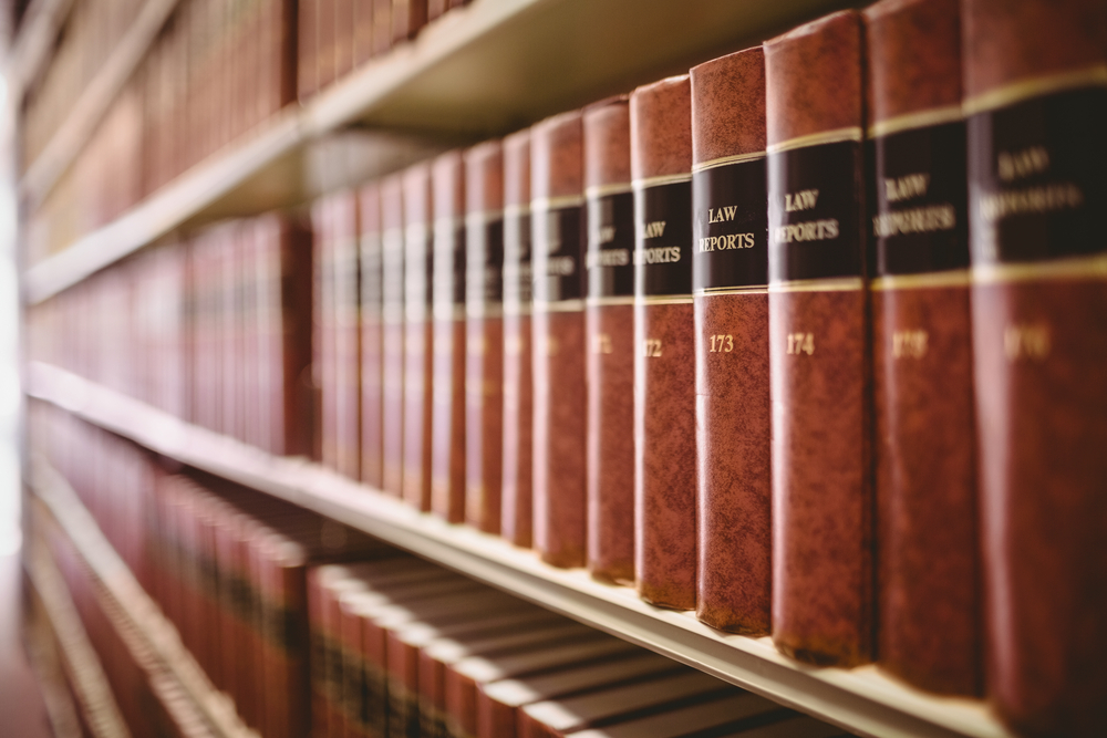 Close up of a lot of law reports in library-1